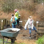 Girl Scouts turning compost